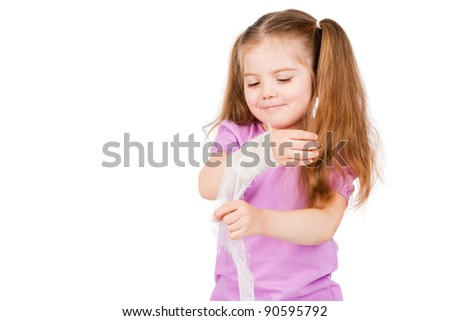 child's hand with a bandage