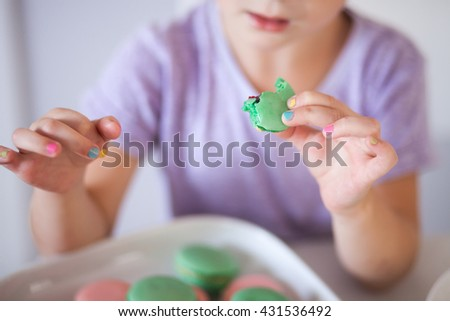 Child's hand with marshmallows
