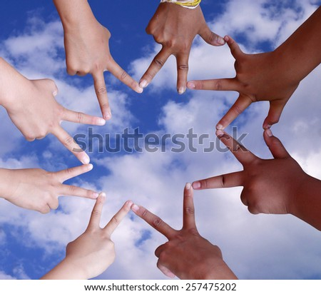 child's hands make the star isolated on sky and clouds background - stock photo