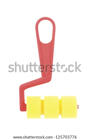 Child's red and yellow paint roller isolated on a white background.