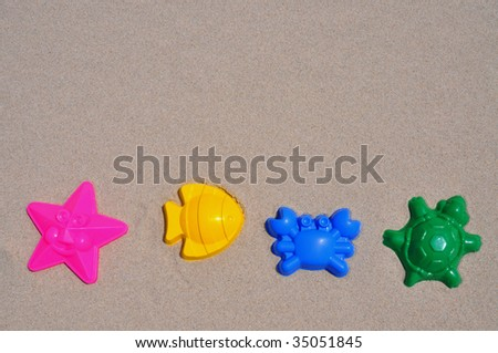 Child's sand toys on beach, room for copy space - stock photo
