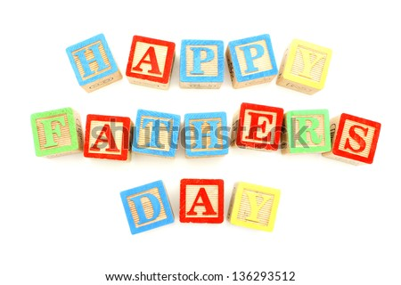 Child's toy block letters spelling Happy Fathers Day over white