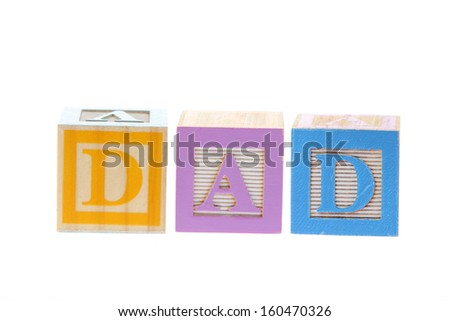Child's wooden blocks with letters spelling DAD - stock photo