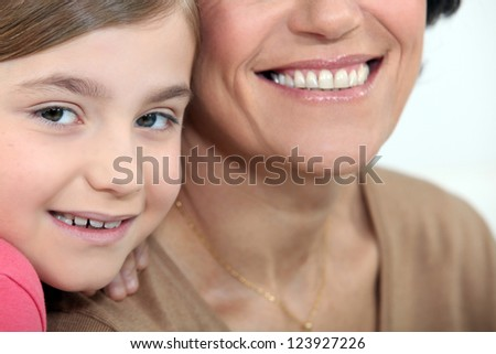 Child sharing a moment with her mother - stock photo