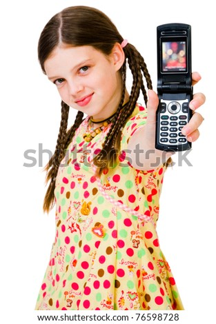 Child showing a mobile phone and smiling isolated over white