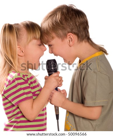 Child singing with a microphone. Funny little girl and boy isolated on white background. Beautiful caucasian model. - stock photo