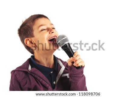 Child singing with microphone, isolated on white background. - stock photo