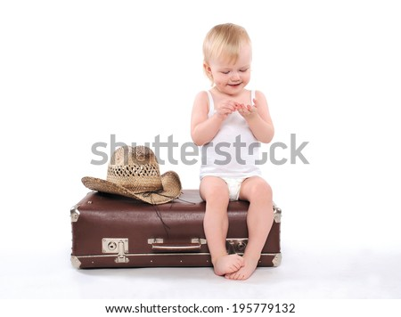Child sits suitcase counts money on tours, travel, vacation - concept - stock photo