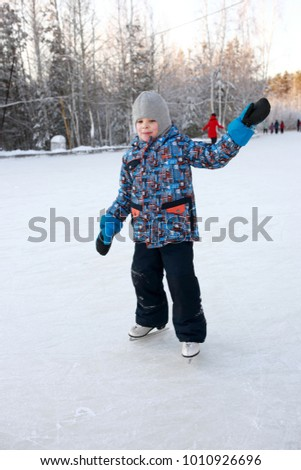 Child skating in park in the evening