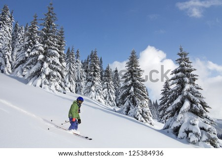 child skiing in powder snow in beautiful weather