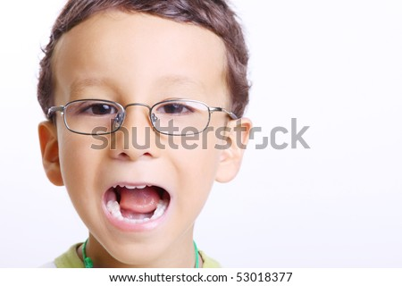 Child smiling with his mouth open and looking at the camera