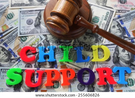 Child Support letters with gavel and cash                                - stock photo