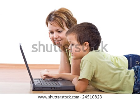 Child surfing the net under supervision - isolated, focus on the boy face