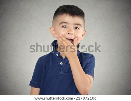Child surprised. Closeup portrait headshot boy with astonished face expression, opened mouth, isolated grey wall background. Human emotions, body language, perception. Unexpected discovery, reaction - stock photo
