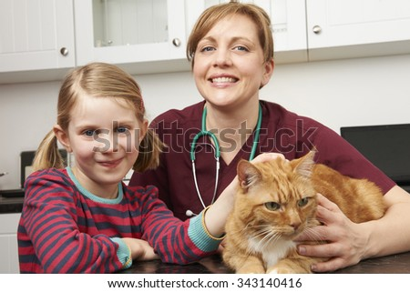 Child Taking Cat To Vet To Be Examined - stock photo