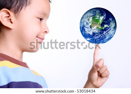 child taking the earth on his finger with a gesture of happiness - stock photo