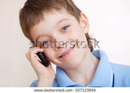 Child, talking on the mobile phone - stock photo