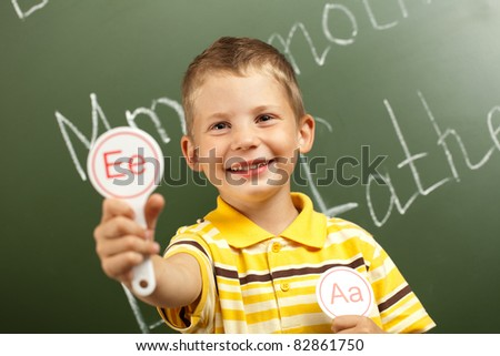 child to school with letters - stock photo