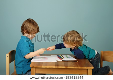 Child, toddler playing with toy trains on tracks, playtime, games - stock photo