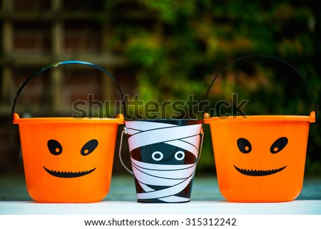 Child Trick or Treat Empty Halloween Buckets are Ready for the Candy Treats, Pumpkin and Mummy Style - stock photo