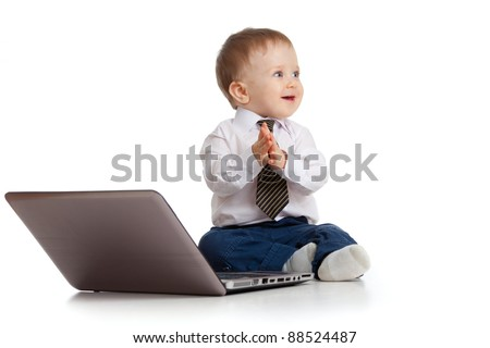 Child using a laptop and clapping his hands - stock photo