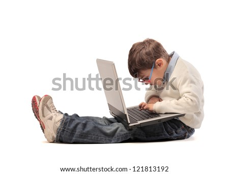 Child using a laptop computer - stock photo