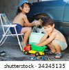 Child washing car and toy car - stock photo