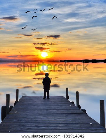 child watching the sea, - stock photo