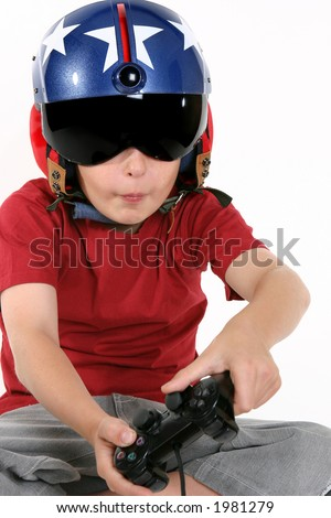 Child wearing helicopter pilot helmet with sunvisor and ear muffs, playing a flight simulator game. - stock photo