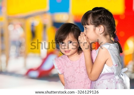 Child whispering. - stock photo
