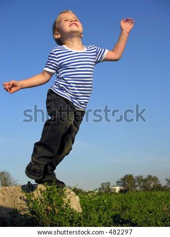 child will jump - stock photo