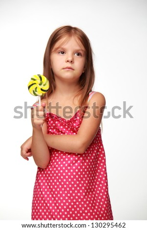 Child with a big lollipop - stock photo