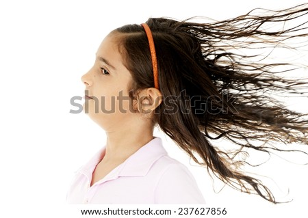 Child with a fan in her hair . - stock photo