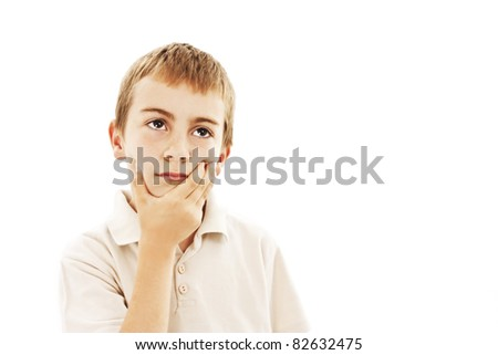 Child with a pensive expression looking up. All on white background. - stock photo