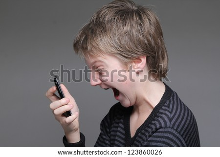 Child with a phone - stock photo