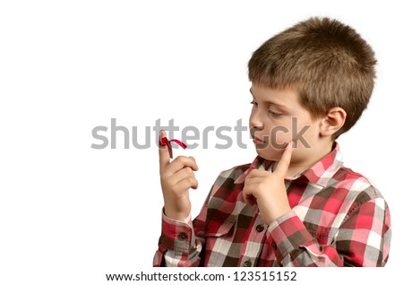 child with a red bow on finger to not forget things - stock photo