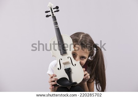 Child with a violin - stock photo