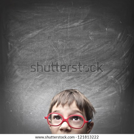 Child with an empty blackboard over his head - stock photo