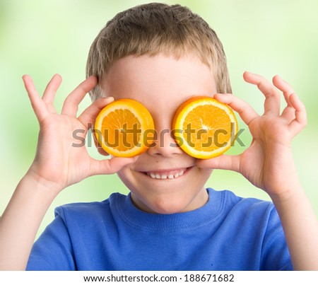 Child with an orange outdoors - stock photo