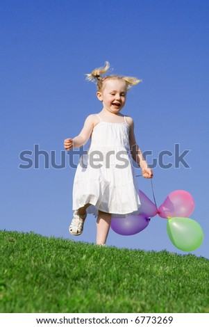 child with balloons - stock photo