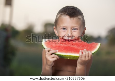 child with big red slice of watermelon  - stock photo