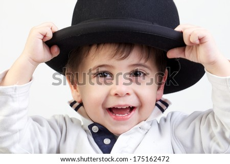 child with bowler hat