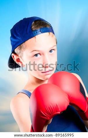 child with boxing gloves fights for a best future