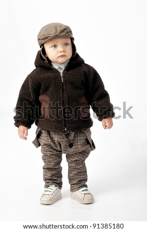 child with brown coat - stock photo