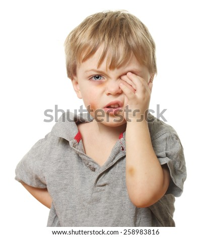 Child with bruise wiping tears isolated on white background. Domestic and family violence concept. - stock photo