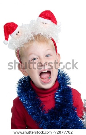 Child with Christmas accessories screaming, studio shot