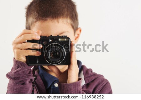 Child with digital compact camera, isolated on white background. - stock photo