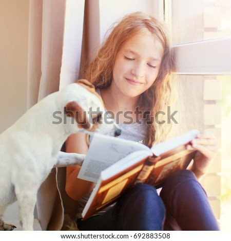 Dog And Girl Reading A Book