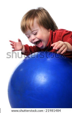 Child with Down Syndrome smiling and playing with ball isolated over a white background. - stock photo