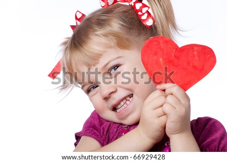 Child with drawn heart